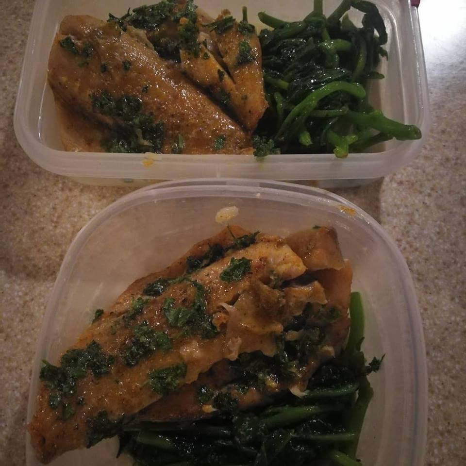 Sliced fish and spinach in meal prep