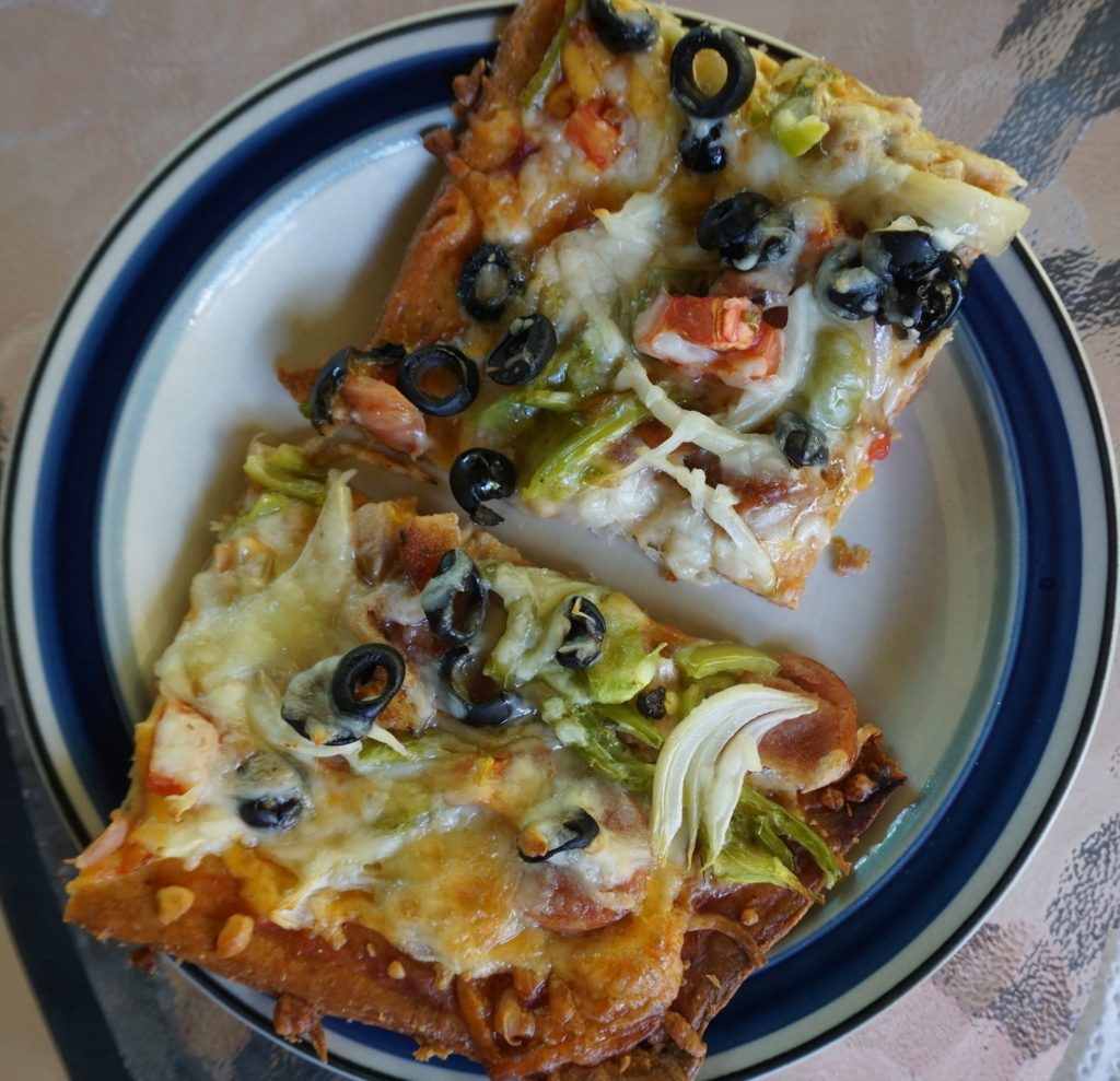 Pizza made with a mozzarella/almond flour dough & topped with loads of veggies