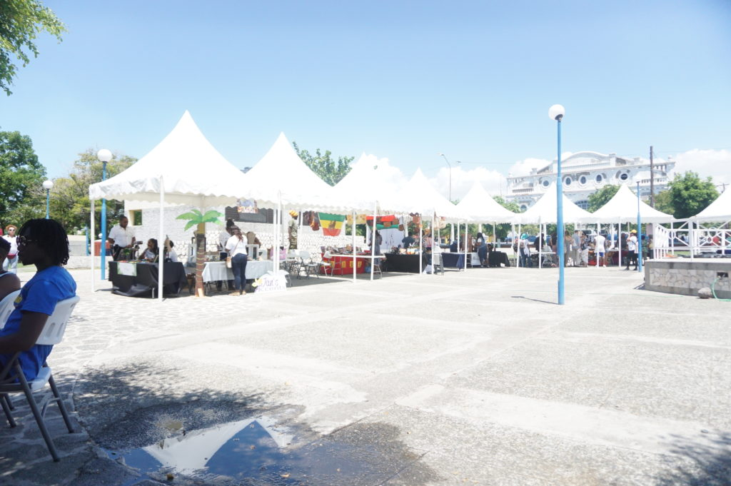 Market Street set up in the St  William Grant Park Downtown Kingston. The historic Ward Theater currently being refurbished is in the background.