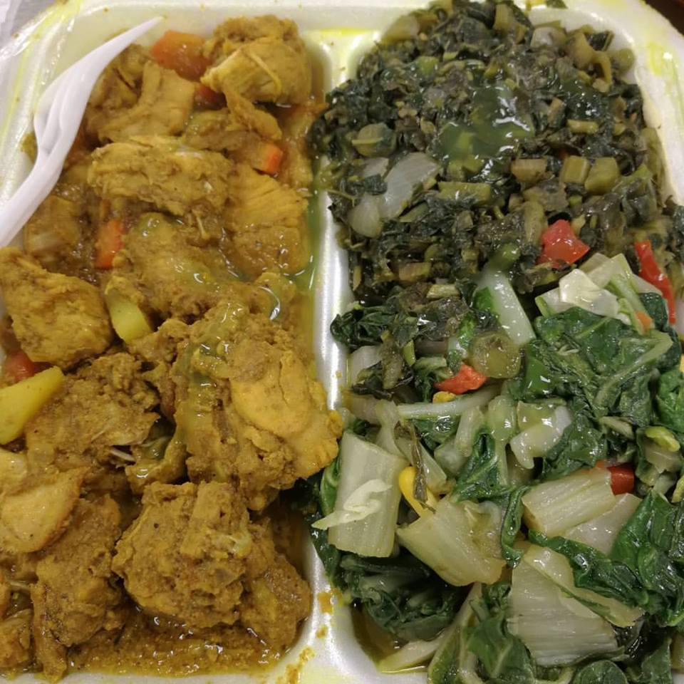 Curried chicken and callaloo with pak choi