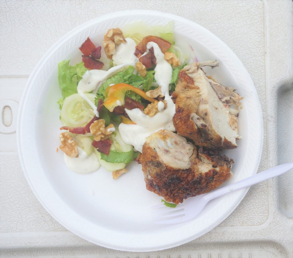 Rotisserie chicken with a well dressed salad